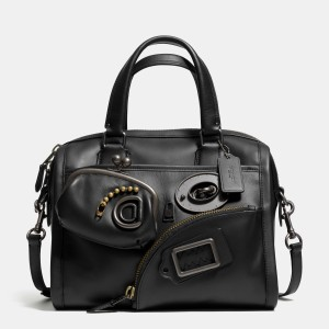 Zippy, the Surrey Satchel likes to eat turnlocks, make-up and credit cards